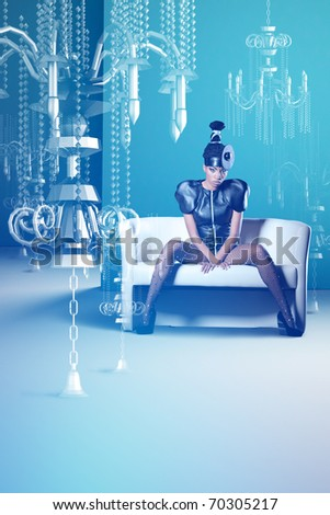 African women in dress siting with hologram chandelier - stock photo