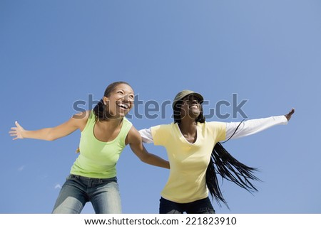 African women with arms outstretched - stock photo