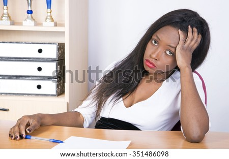 African young business girl in the office - stock photo