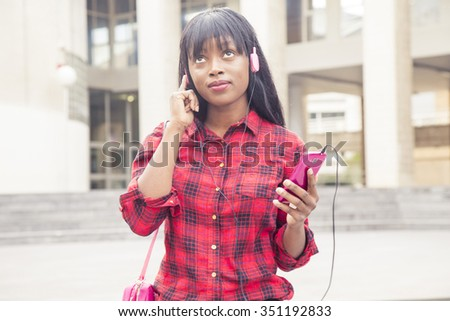 African young girl listening to music