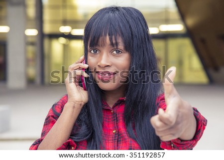 African young girl talking on the phone