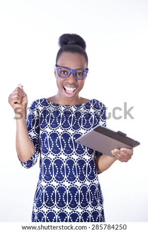 African young girl with electronic tablet - stock photo