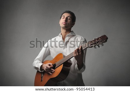 African young man playing the guitar - stock photo