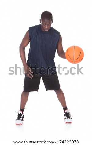 African Young Man With Basketball Isolated Over White Background