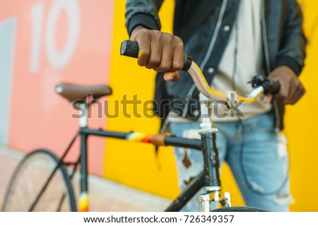 African young man with fixed gear bicycle.