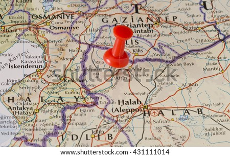 Afrin marked on map with red pushpin. Selective focus on the word Afrin and the pushpin. Pin is in an angle. Midground is sharp while foreground and background is blurry. - stock photo