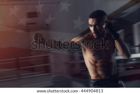Afro american boxer male sparring in motion dynamics. Side view, muscular man on the background boxing gym and transparent background United States flag.