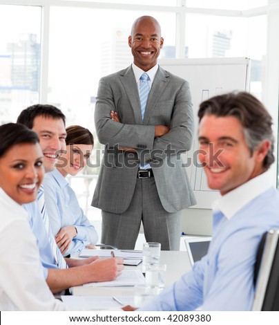 Afro-american businessman giving a presentation to his team in the office - stock photo