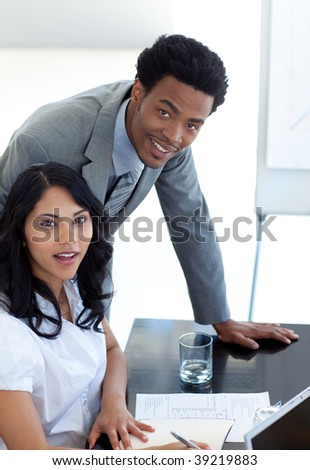 Afro-American businessman working with his colleague in office