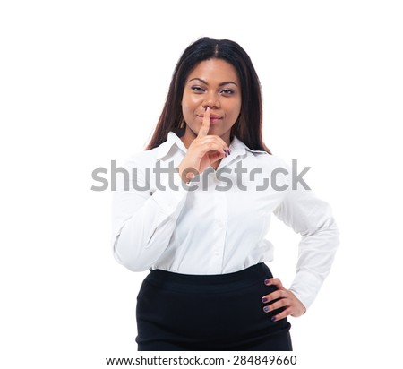 Afro american businesswoman with finger over lips. Be quiet!!! Standing isolated on a white background. Looking at camera - stock photo