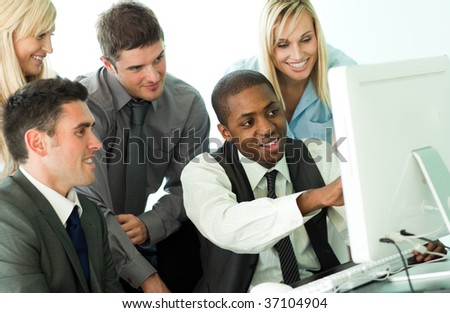 Afro-American manager explaining a job to his team from a computer - stock photo