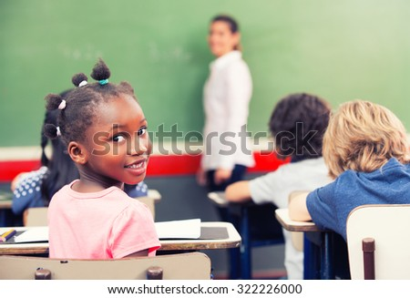 Afro american schoolgirl smiling during a lesson.