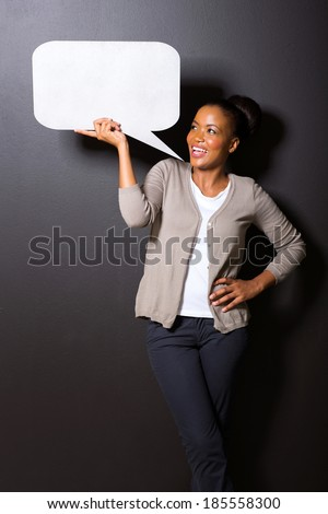 afro american woman holding speech bubble isolated on black background - stock photo