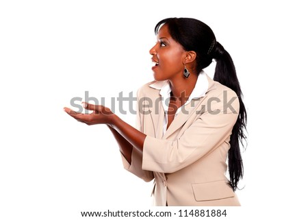 Afro-american young female looking to her left against white background - stock photo