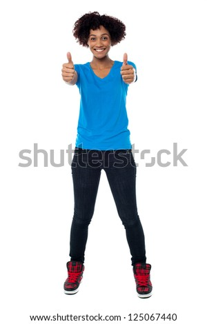 Afro American young woman showing double thumbs up to the camera.