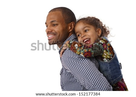 Afro father carrying cute little girl piggyback, both smiling.