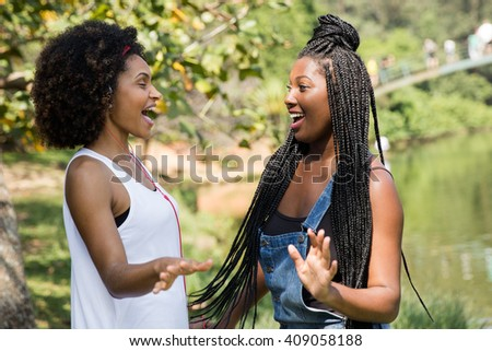Afro friends enjoying a beautiful day on the park - stock photo