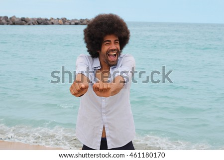 Afro man on the beach