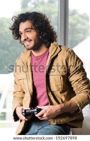afro man playing video games - stock photo