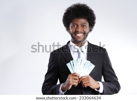 afro man smiling with money