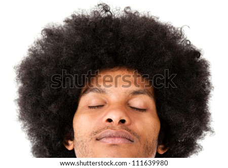 Afro man with eyes closed - isolated over a white background - stock photo