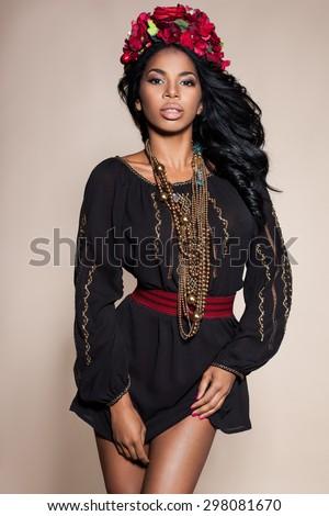 Afro Ukrainian girl in embroidery (Ukrainian national dress) - stock photo