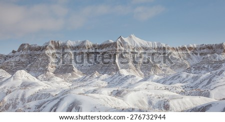 After a fresh snowfall, a Winter Mountain Scene in Badlands park.  - stock photo