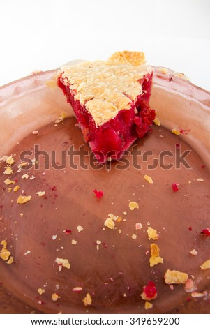 After a good thanksgiving dinner this is the leftover cherry pie - stock photo