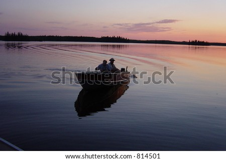 After a Night of Fishing a Boat Comes into Dock - stock photo