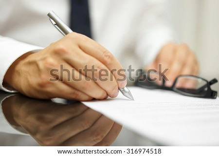 After a review of the sales contract Businessman finished deal - stock photo