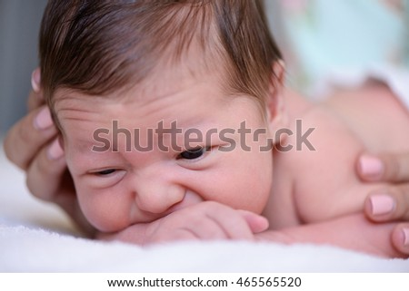 After childbirth newborn baby lay in mother's arms