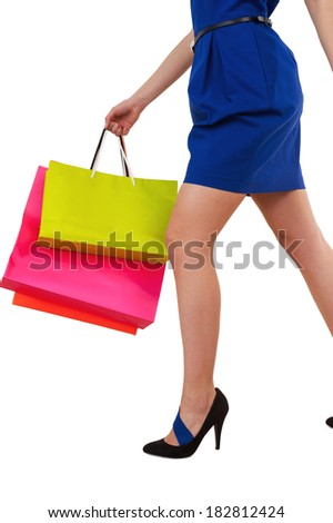 After day shopping. Cropped image of young woman carrying her bags - stock photo
