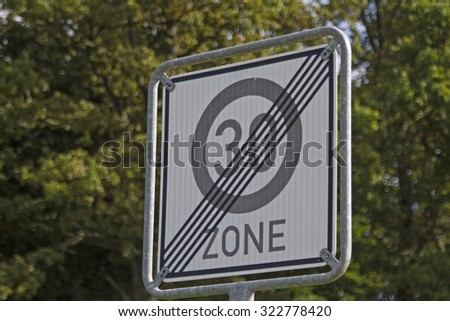After leaving the residential area the speed limit is canceled - stock photo