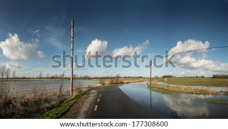 after much rain a road on boreham essex has become flooded - stock photo