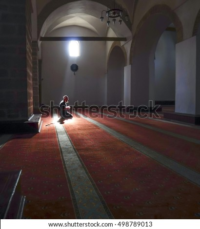 After prayers, Muslims praying in a mystical environment