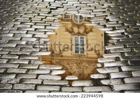 After rain in Prague - reflection of the house in puddle - stock photo