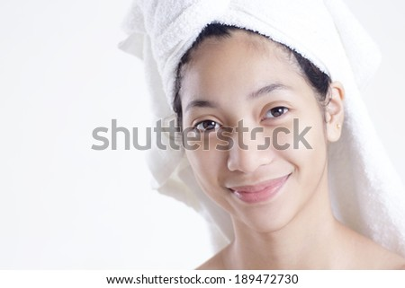 After shower portrait of a young asian lady in light gray background. - stock photo