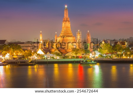 After sunset at Wat Arun temple along with Bangkok river thailand - stock photo