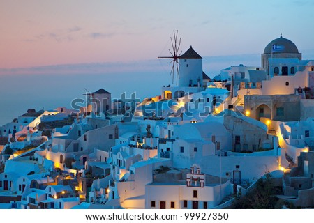 After sunset hour at Oia village of Santorini island in the  Cyclades, aegean sea, Greece. - stock photo