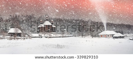 After sunset, the traditional Ukrainian village began snowfall and blizzards, snowdrifts pout and covered the roads and footpaths. Thick forest and gardens beautiful pattern on the background of sky - stock photo