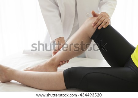 After work of women undergoing a thigh muscle massage. - stock photo