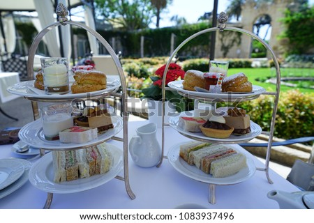 https://thumb1.shutterstock.com/display_pic_with_logo/167494286/1083937496/stock-photo-afternoon-tea-in-a-beautiful-garden-in-malta-1083937496.jpg