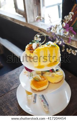 Afternoon Tea Set. High Tea sweet desserts on stand. - stock photo