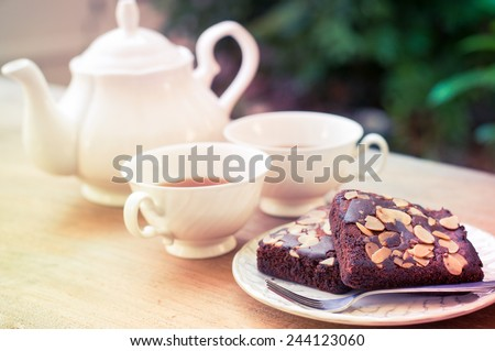 Afternoon tea with brownie almond cake - stock photo