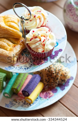 Afternoon tea with cake stand set - stock photo
