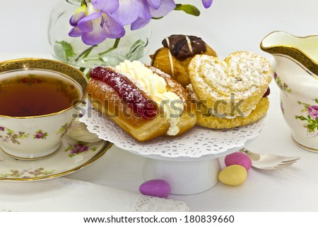 Afternoon tea with cakes and antique tea cup. - stock photo