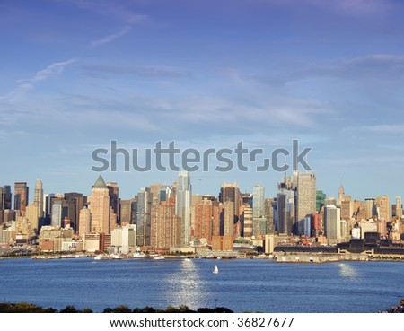 afternoon vibrant capture of new york midtown over hudson - stock photo