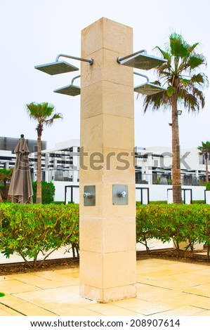 AGADIR, MOROCCO - JUL 09, 2014: Beach shower at  Hotel Sofitel Agadir Royalbay Resort is located in the magnificent beach of Atlantic ocean with golden sand and imbued  the spirit of modern luxury