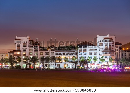 Agadir seafront promenade at the night, Morocco. Agadir is a major city in Morocco located on the shore of the Atlantic Ocean, near the Atlas Mountains. - stock photo