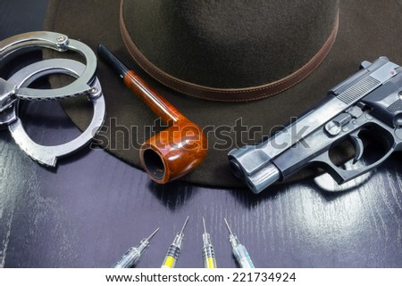 against drugs, wives pistol semiautomatic hat and pipe - stock photo